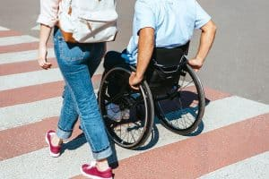 Woman and mani in a wheelchair in a crosswalk